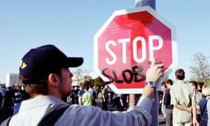 An Otpor member vandalises a traffic sign during protest demonstrations in Belgrade, Yugoslavia in 2000.