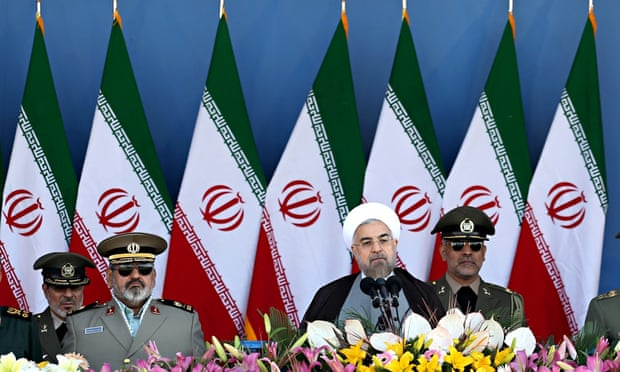 Iran's President Hassan Rouhani (second right) speaks in front of the mausoleum of the late rAyatoll