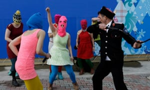 Members of the punk group Pussy Riot, including Nadezhda Tolokonnikova and Maria Alekhina, being attacked during a protest in Sochi, Russia, in February 2014.