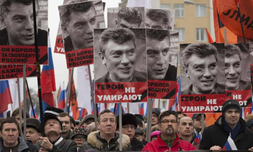 Protesters march in Moscow on 1 March in memory of slain opposition leader Boris Nemtsov.