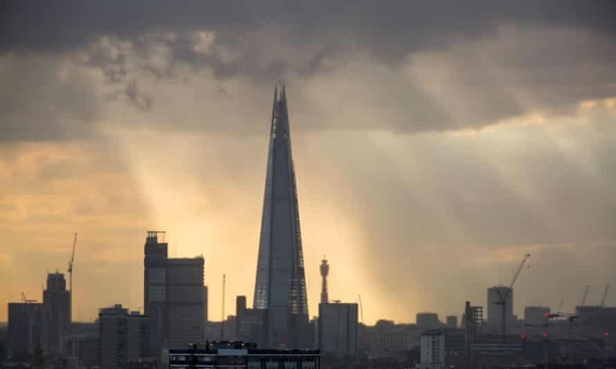 Dramatic rainstorm sundown over The Shard Building in London city
