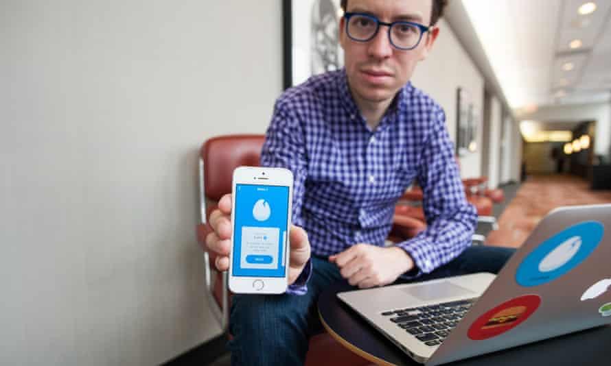 Luis von Ahn shows off Duolingo on his iPhone.