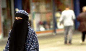 A fully veiled Muslim woman in Tower Hamlets. The leaked draft, which calls for the government to be more assertive in promoting 'British values', says extremism has been allowed to go unchallenged in the east London borough.