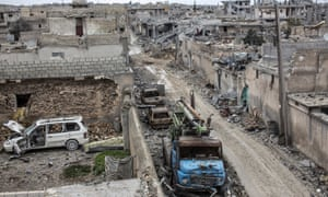 Rubble and damaged buildings are seen in the devastated Syrian city of Kobani in January.