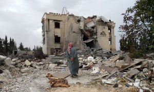 A Syrian man inspects the damage following a reported US-led coalition air strike against the headquarters of the Nusra Front in September.