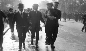 Police remove Emmeline Pankhurst from a suffragette protest, 1914. 'Women who don't vote are telling