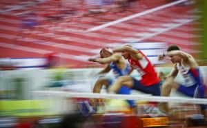 Konstadinos Douvalidis of Greece, Petr Svoboda of the Czech Republic and Lawrence Clarke of Great Britain compete in the Men's 60 metres Hurdles Semifinal.