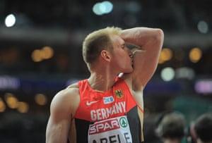 Germany's Arthur Abele celebrates during men's heptathlon shot-put event.