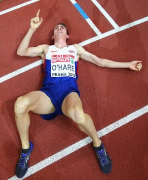 Bronze medallist Chris O'Hare of Great Britain & Northern Ireland lies on the track after the Men's 1500 metres Final.