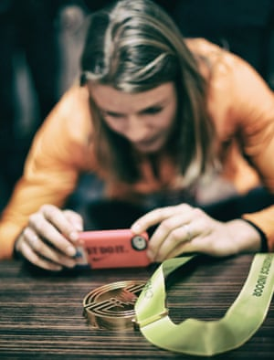 Daphne Schippers of the Netherlands takes a photo of her her Gold medal from the Womens 60m Final.