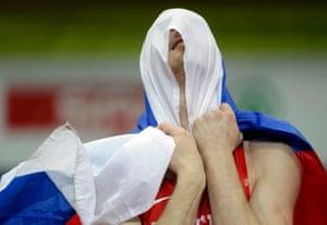 Daniyil Tsyplakov of Russia celebrates after winning the men's high jump gold.