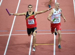Belgium 4x400m relay team member Kevin Borlee races past Poland's Jakub Krzewina, right, during the final stages of the final.