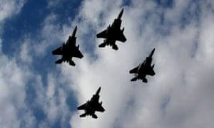 F15 warplanes fly over the Saudi capital Riyadh during an officers graduation ceremony at King Faisal Air Force University. Saudi Arabia now imports  more defence equipment than any other country.