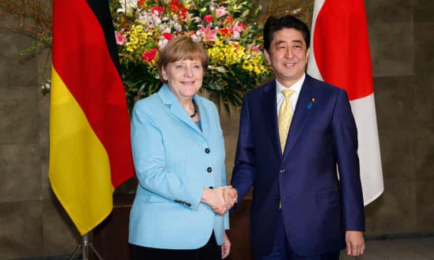 Angela Merkel with Shinzo Abe in Tokyo on 9 March.