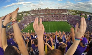 Fans cheer during the inaugural MLS soccer game between New York City FC and Orlando City, Sunday, March 8, 2015, in Orlando, Fla. Orlando City's Kaka scored in extra time to give the Lions a 1-1 tie in front of an announced crowd of 62,510 at Citrus Bowl Stadium.
