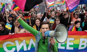 A gay rights activist raises his fist as he leads a gay rights activists march during May Day rally in St. Petersburg, Russia.