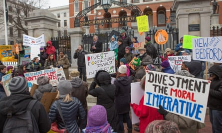 Environmentalists rally in Boston to demand state legislators support a bill that would require divestment from the state's fossil fuel holdings,  26 February 2014 .