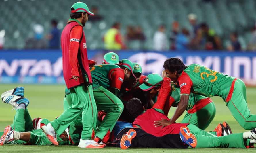 Bangladesh players celebrate after beating England.