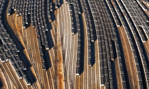 Aerial view of coal trains, tracks and port along river, Newport, Virginia, USA