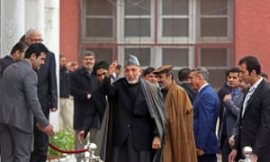 Hamid Karzai, centre, arrives at parliament in Kabul on Saturday.