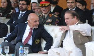 Ashraf Ghani, left, and Pakistani prime minister Nawaz Sharif watch cricket together in Islamabad, November 2014.