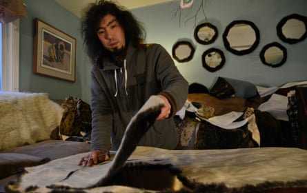 Peter Williams making clothes from sea otter skin.