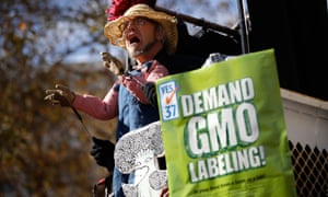 Jonathan Youtt, of Oakland, performs a puppet show during a rally in support of the state's upcoming Proposition 37 ballot measure in San Francisco, California October 6, 2012. The initiative, commonly known as the California Right to Know Genetically Engineered Food Act, would require mandatory labeling of genetically-modified raw and processed food products and prohibit products containing such to be called natural.