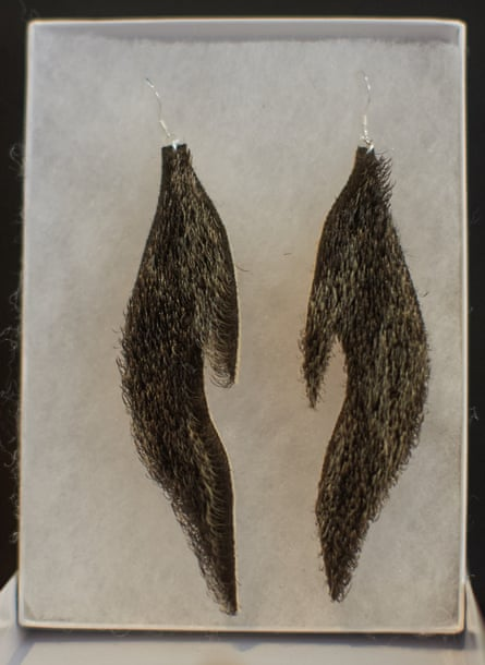 Sea otter earrings by Peter Williams.