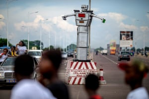"An 8-foot-tall humanoid traffic robot equipped with a rotating chest and video cameras controls and monitors traffic on a busy road in Kinshasa. These photographs form part of the <a href=""http://imagingambassadors.sony.net/futureofcities/about"">#FutureofCities</a> campaign, a social documentary initiative run by Sony's Global Imaging Ambassadors"