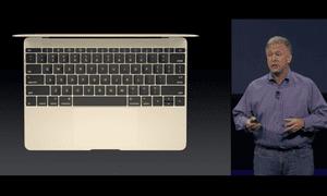 Phil Schiller demonstrates the new Macbook.