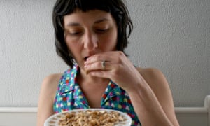 Becky Striepe eating dry roasted cashew nuts.