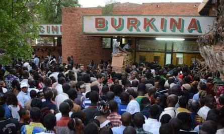 People wait outside Ciné Burkina in Ouagadougou.