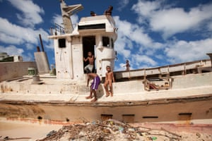 21. A boat washed onto Red Beach during a storm in 2013 now serves as a diving board for the local Betio kids.