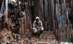 A metal vendor sits in his shop in Old Dhaka, the historic core of Bangadesh's capital city.