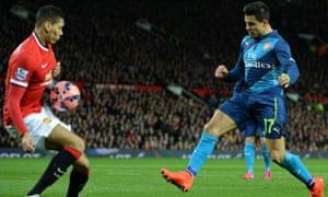 Manchester United's Chris Smalling blocks a shot by Arsenal striker Alexis Sanchez