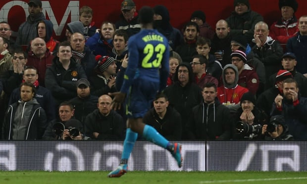 The United faithful unsurprisingly react with indifference after Danny Welbeck celebrates after putting Arsenal back into the lead.