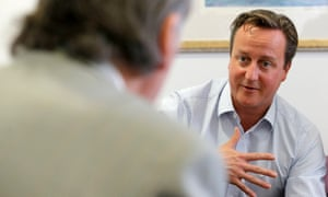 David Cameron on a visit to the children's cancer ward at the John Radcliffe Hospital, Oxford, in September 2013.