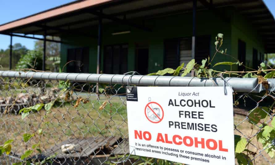 """A sign reading """"Alcohol Free Premises"""" on a fence outside a house in the Indigenous community of Bagot in Darwin"""