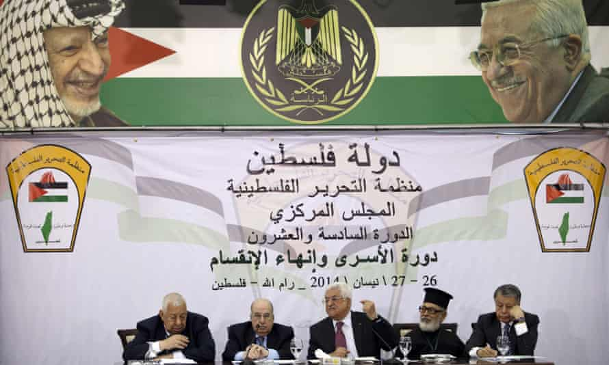 Mahmoud Abbas, centre, speaks at a meeting of he Palestinian Authority's top decision-making body.