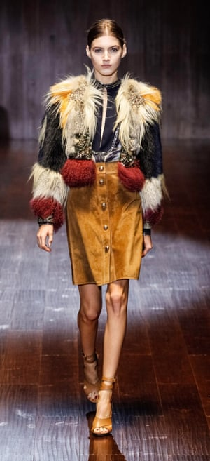 A model does suede on the Gucci catwalk