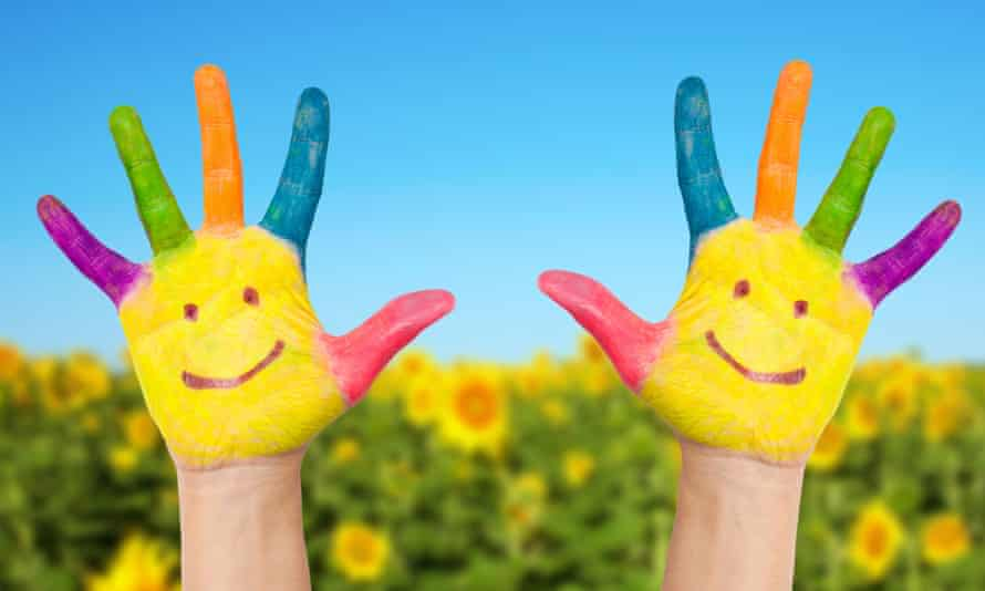 Painted hands with smiley faces