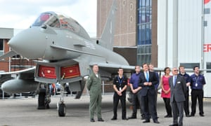 David Cameron watches a Eurofighter Typhoon during a visit to BAE Systems in Warton, Lancashire.