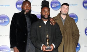 Mercury rising: the exhilarated trio collect last year's award.