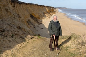 Peter Boggis, standing on part of the sea defences he constructed.