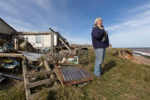 Bryony Nierop-Reading and the remains of her house on the cliff edge at Happisburgh, Norfolk.
