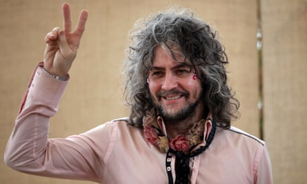 Wayne Coyne, lead singer, guitarist, and songwriter for the U.S. band the Flaming Lips, poses for photos during an interview before performing at the 2015 Cumbre Tajin music festival in Papantla, Mexico, Friday, March 20, 2015. (AP Photo/Felix Marquez)