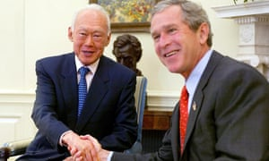 This file photo taken on May 1, 2002 shows US President George W. Bush welcoming Singapore's Senior Minister Lee Kuan Yew (L) to the Oval Office for a meeting at the White House in Washington, DC