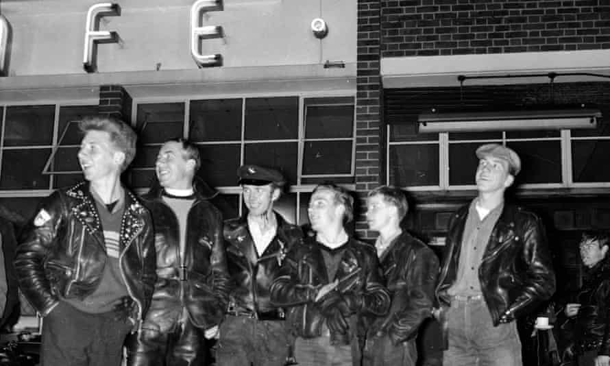 Reverend Bill Shergold of Hackney Wick, London, surrounded by some of the young bikers outside the Ace Café, 29th June 1962.