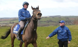 Jonjo O'Neill looks on as his Grand National hope Shutthefrontdoor starts a workout