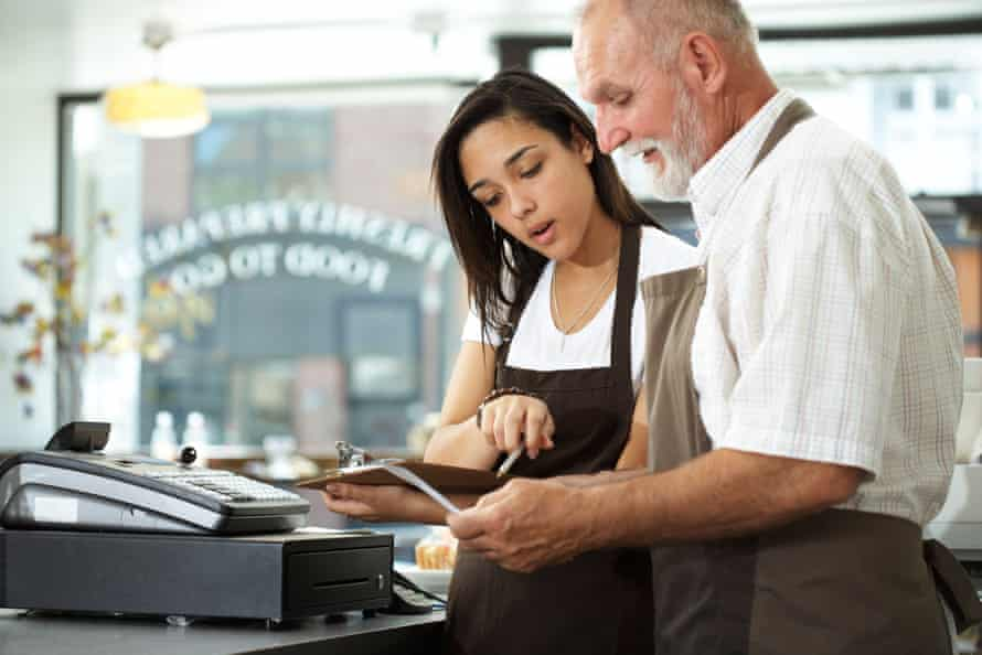 50-60 year-old working with 16-17 year-old in restaurant